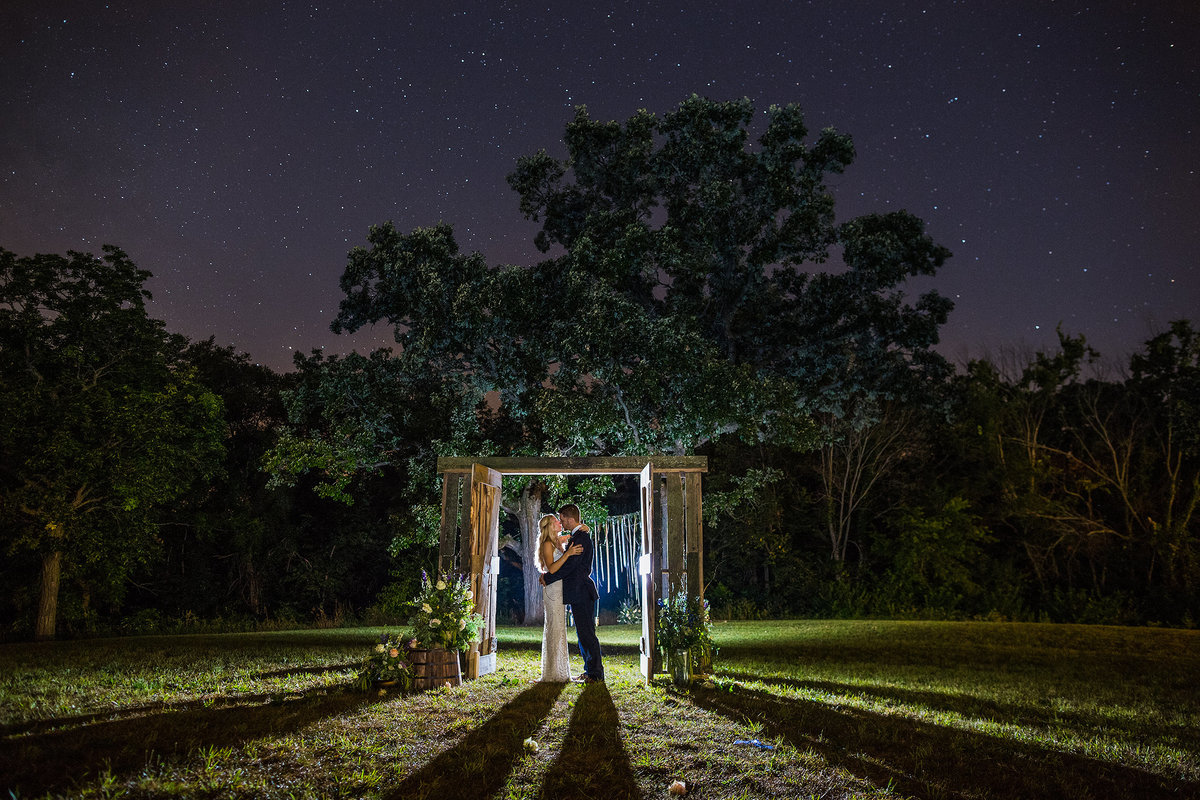 bride and groom under the stars at nighttime