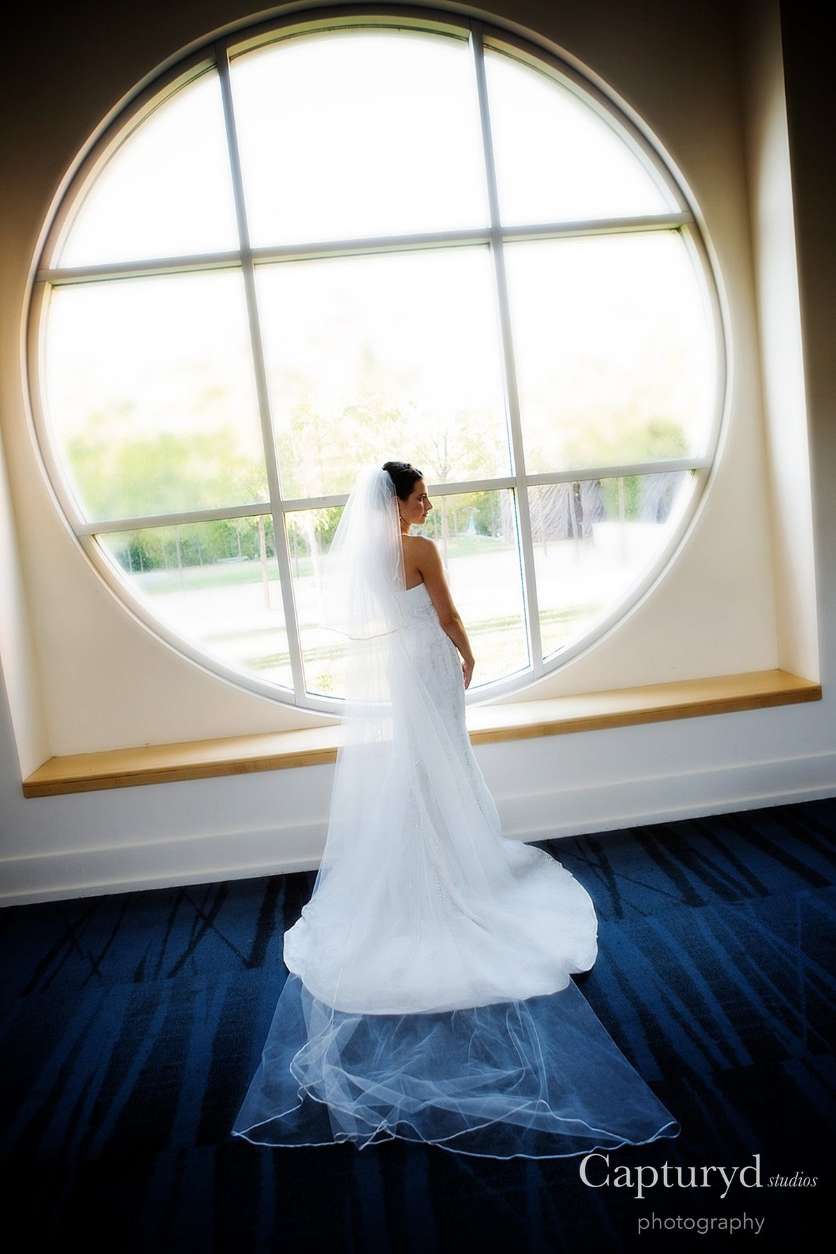 Bride next to window