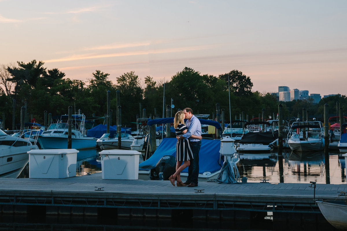 boat dock engagement session after sunset