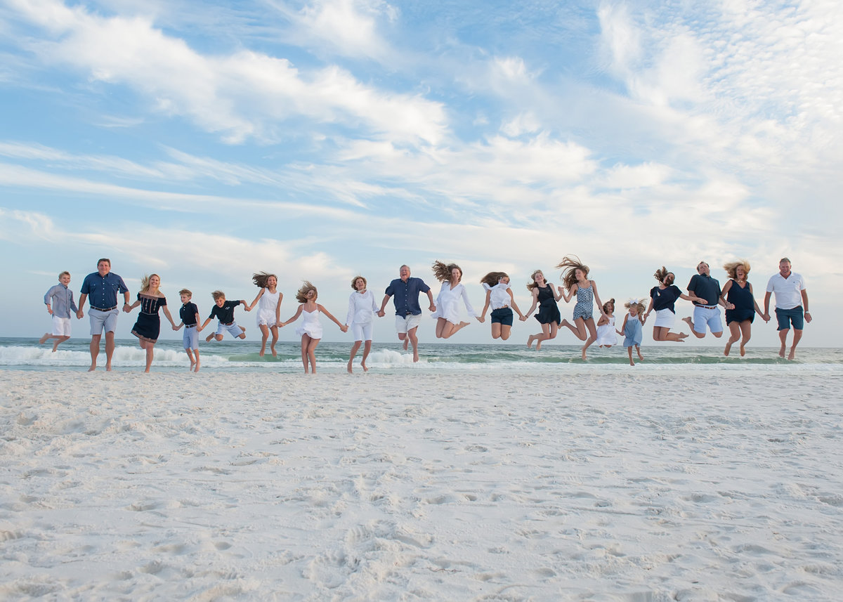 Whole family jumping by the water in Seaside Beach Florida
