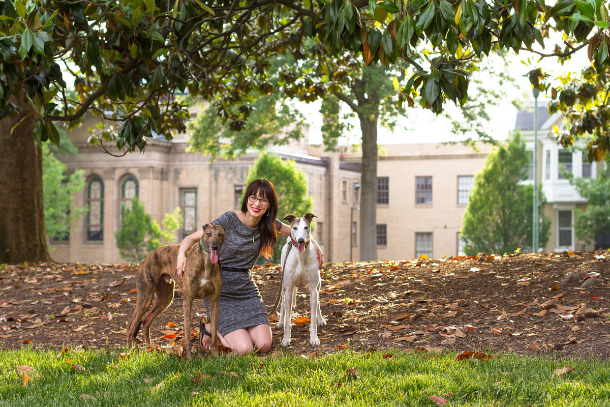 Girl poses with Greyhound dogs in Virginia