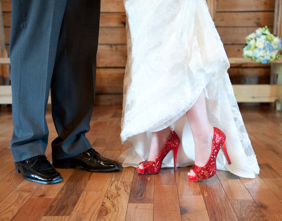 Ruby red sparkly shoes for bride, wedding style at Rustic Oaks in Moorhead. Photos by Kris Kandel