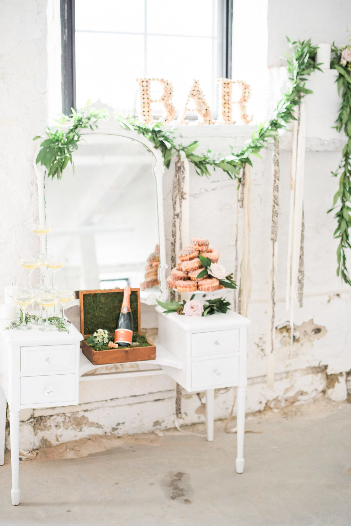 antique champagne bar with donut tower