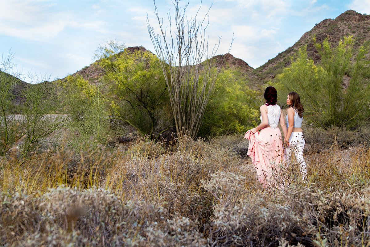 lesbian couple walking in the desert