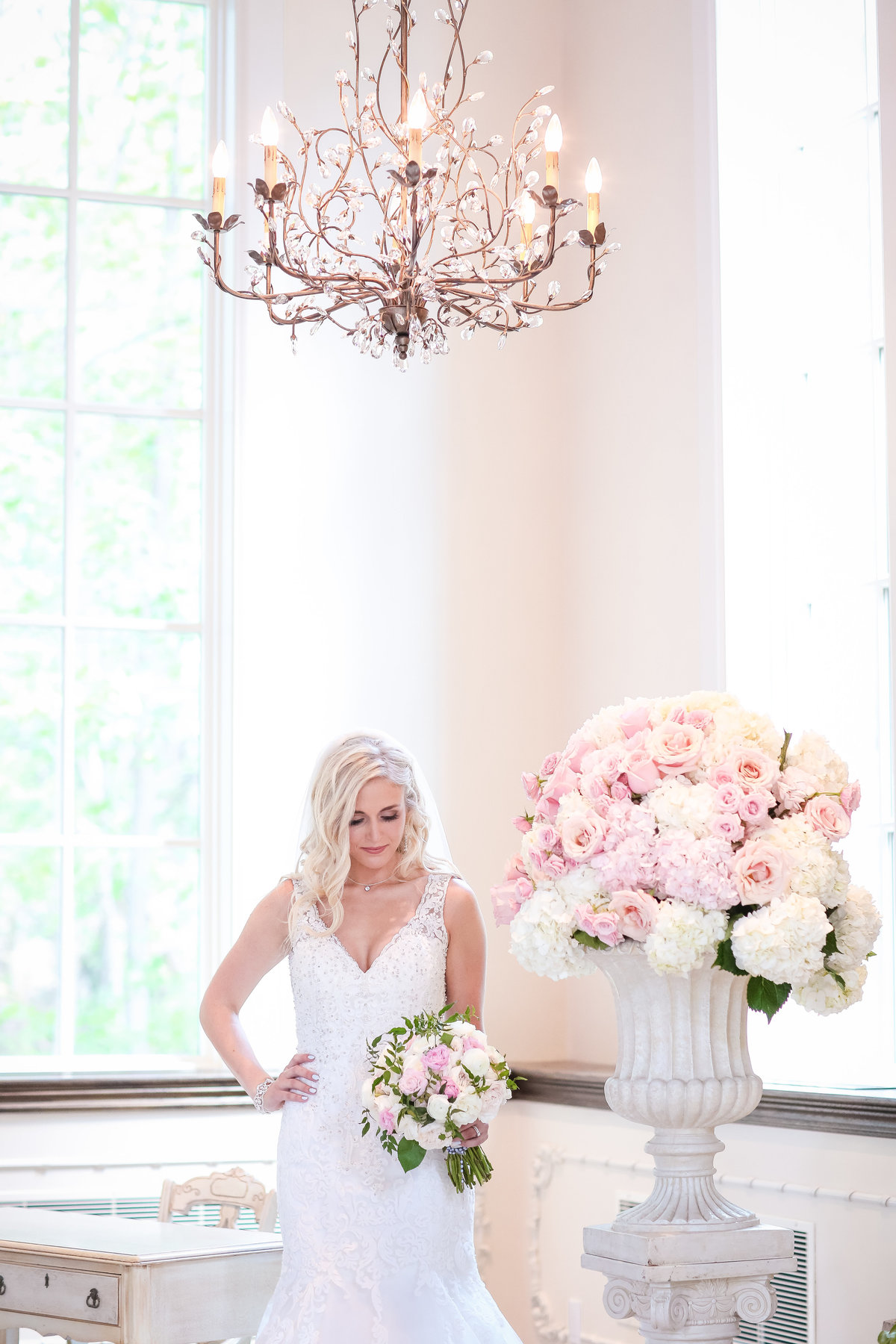 Ancaster Mill Wedding - Millers chapel bride with flowers and chandelier