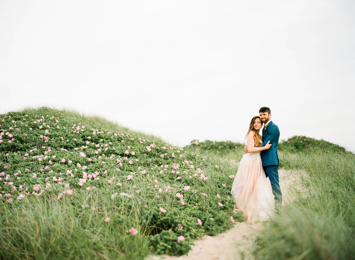 couple in sand dunes nantucket wedding
