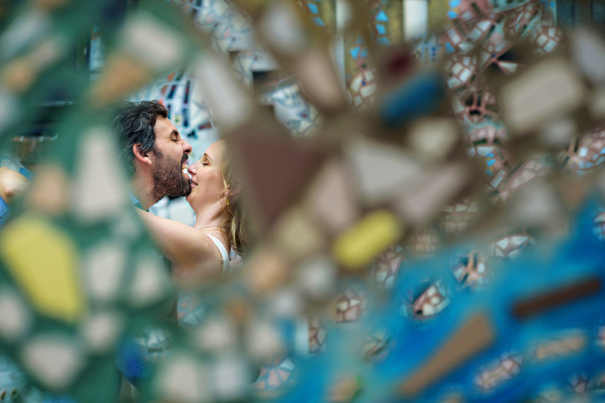 In the mirrors of the south street graffiti artist, reflects a fun engaged couple goofing around.