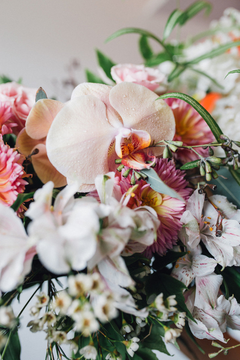 Close up of bridal bouquet peach orchids