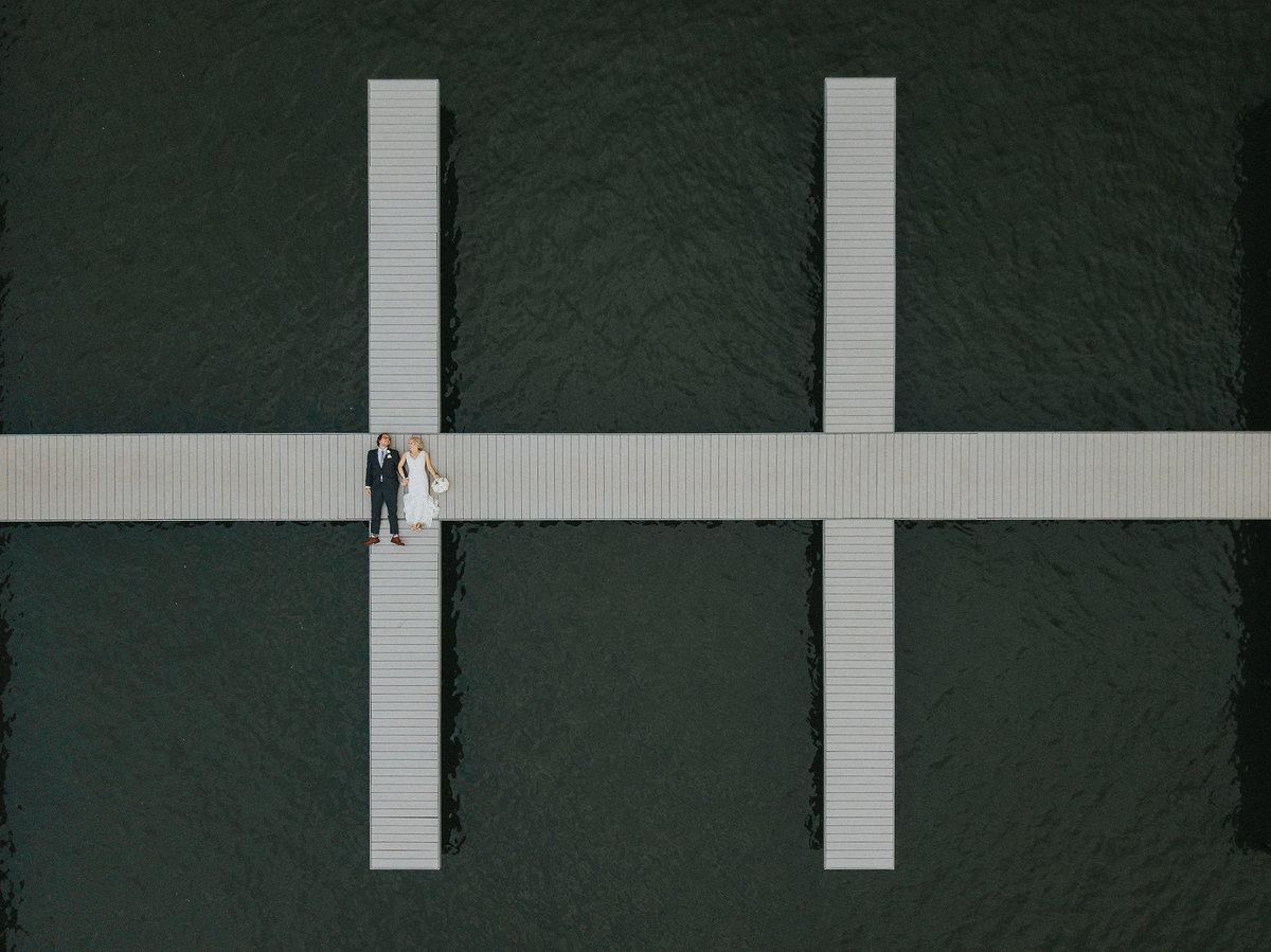 Drone photograph of couple on dock at prairie brewing company in rockford illinois