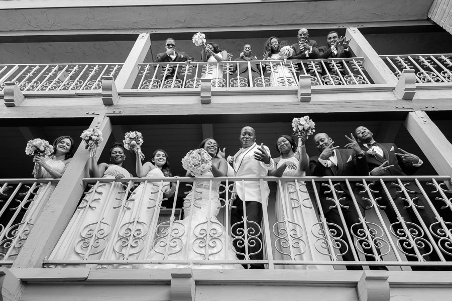 Couple with bridal party on the balcony  cheering