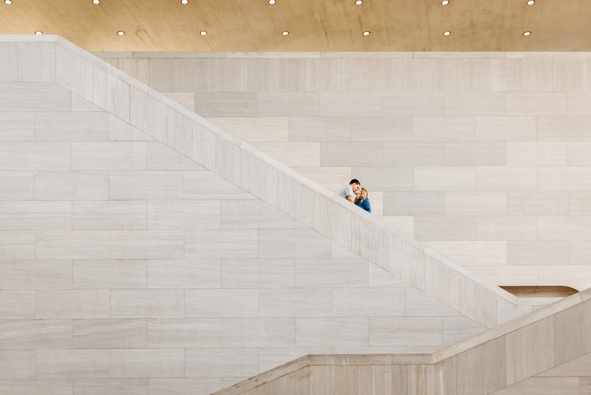 engaged couple on stairs at museum in dc