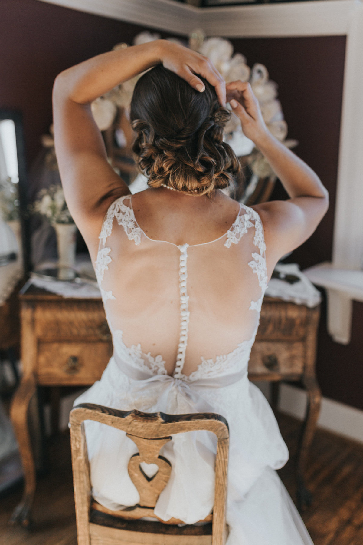Bride getting prepped to walk down the aisle