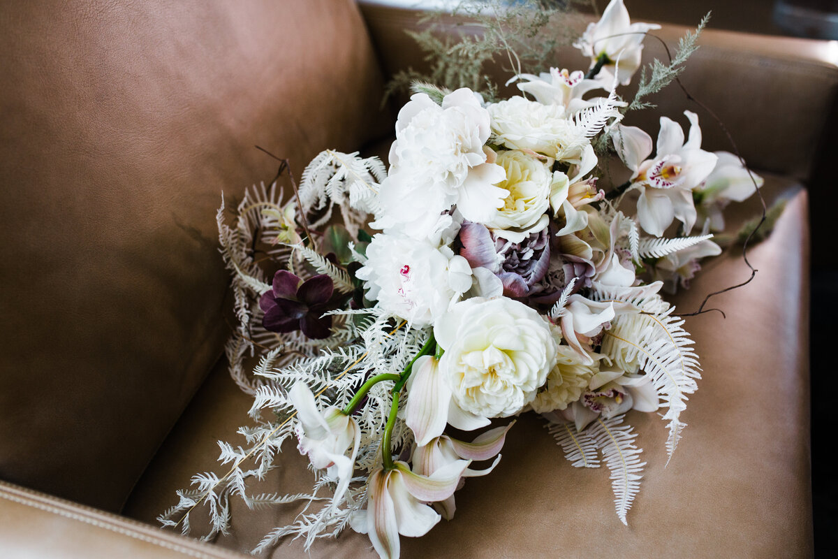 drides bouquet sitting in leather chair