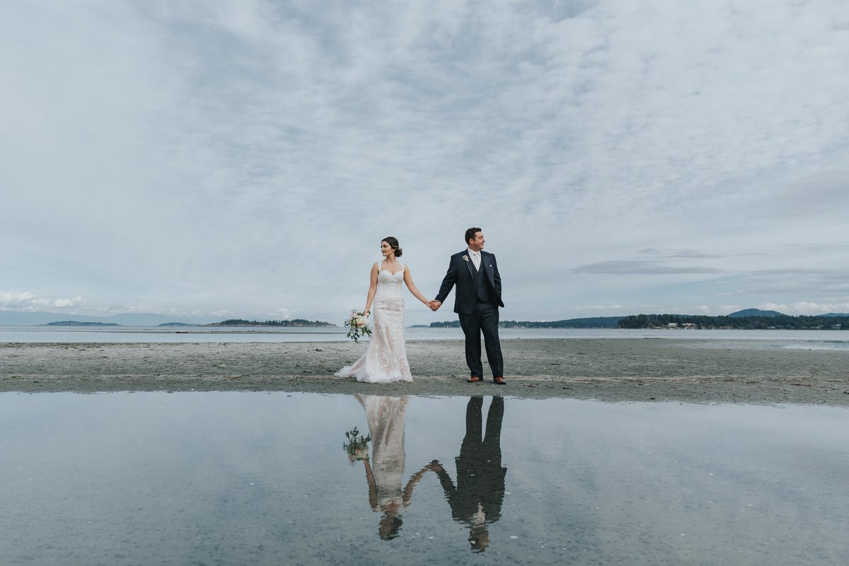 Bride and groom reflections at Rathtrevor Beach in Parksville, BC
