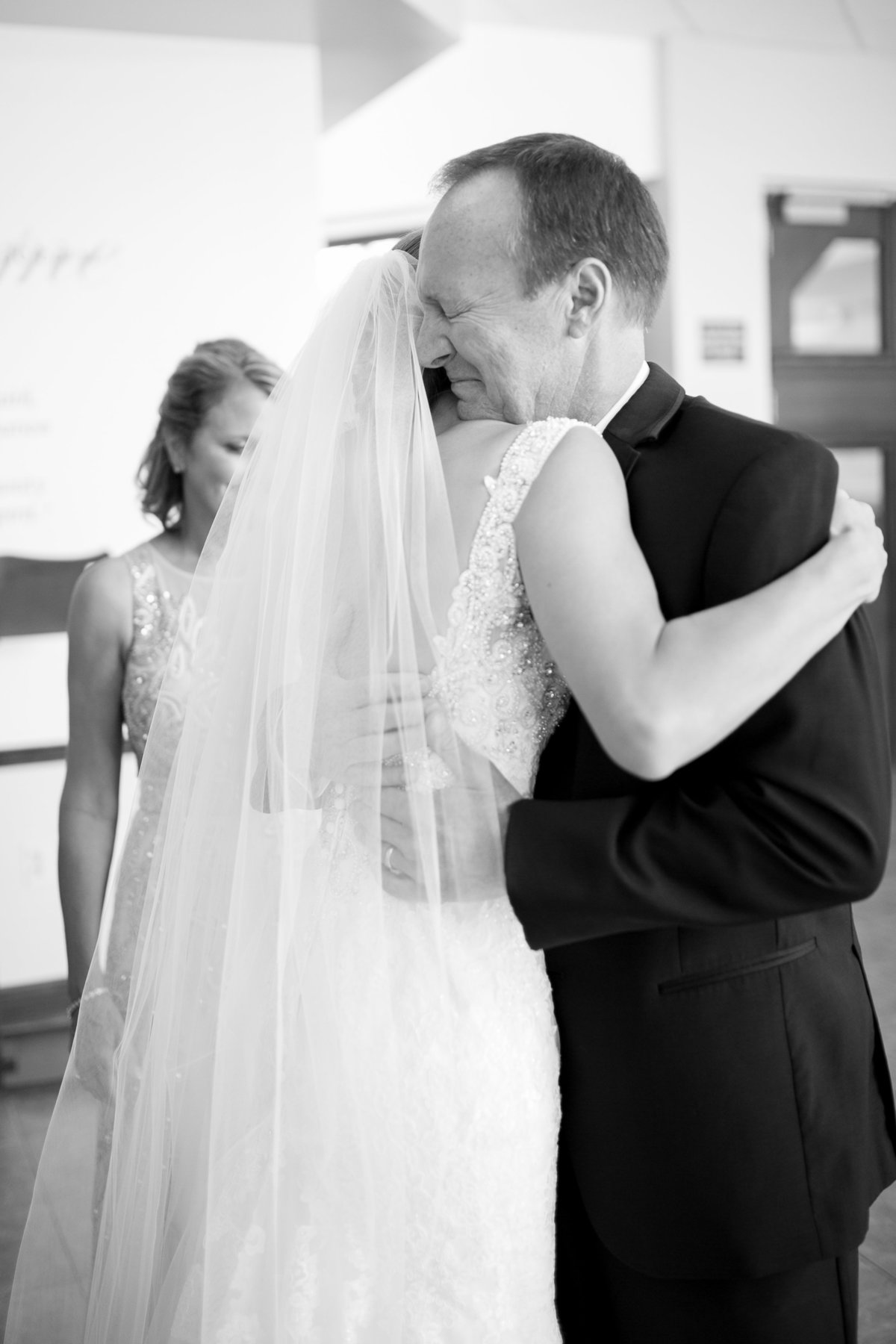 Bride hugging dad after first look