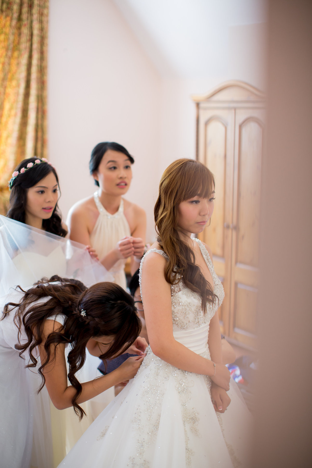 bridesmaids lacing wedding dress at st audries park somerset