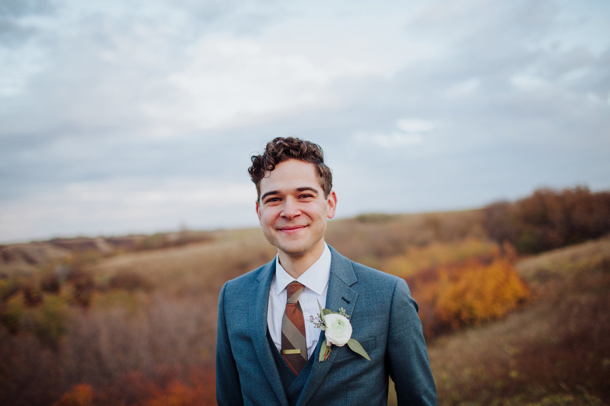 Modern groom in a blue suit. Fall wedding in Lumsden Valley.
