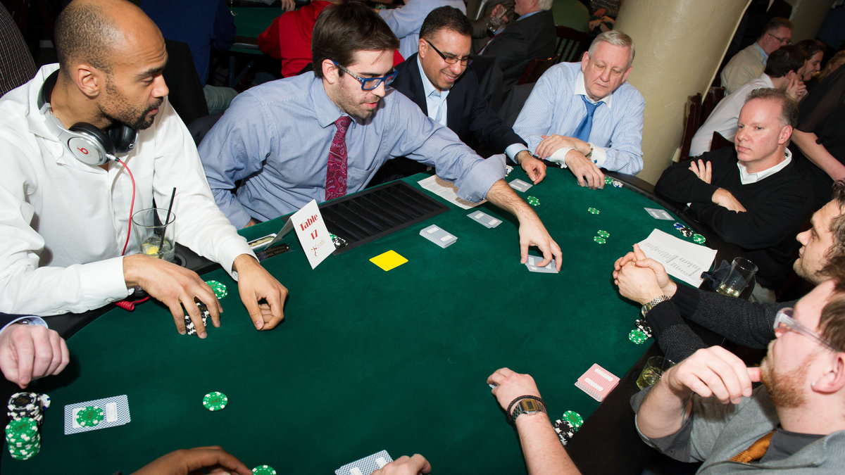 Guests play poker at fundraising event, Chicago Illionis.