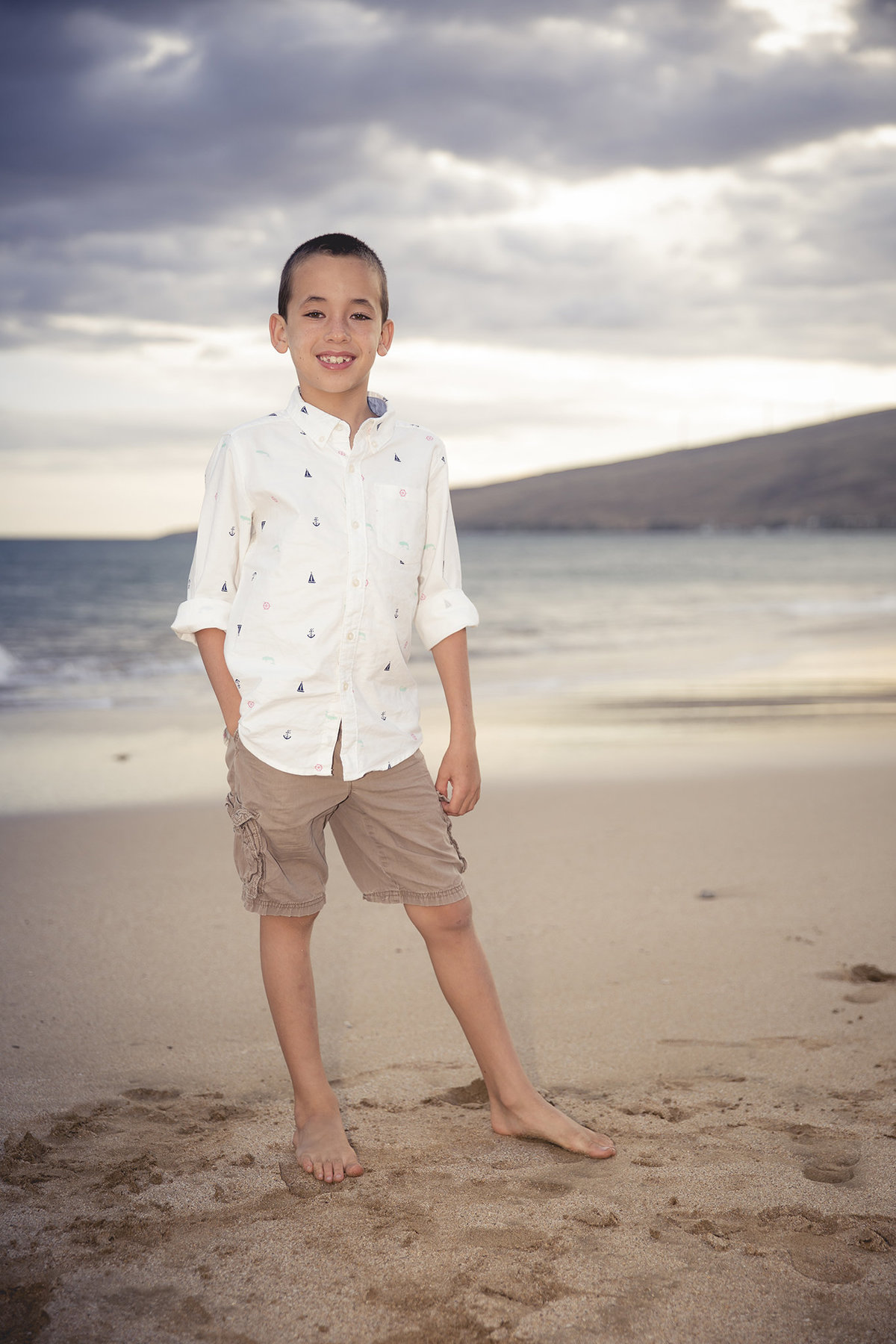 young man on the beach in maui by jacob grant maui hawaii photography
