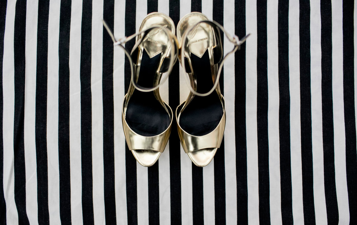 ft lauderdale wedding, gold shoes on black and white stripes