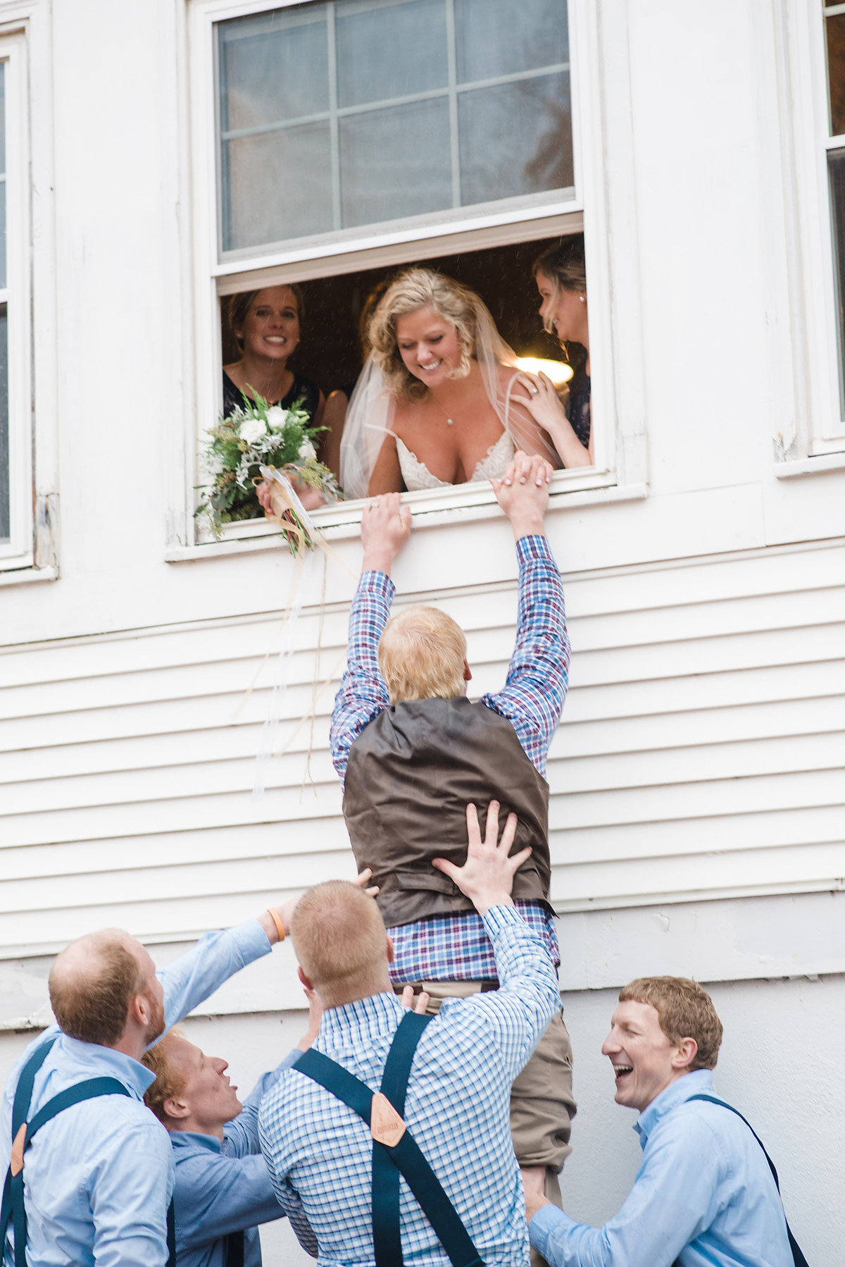 bride and groom in window, rainy wedding day