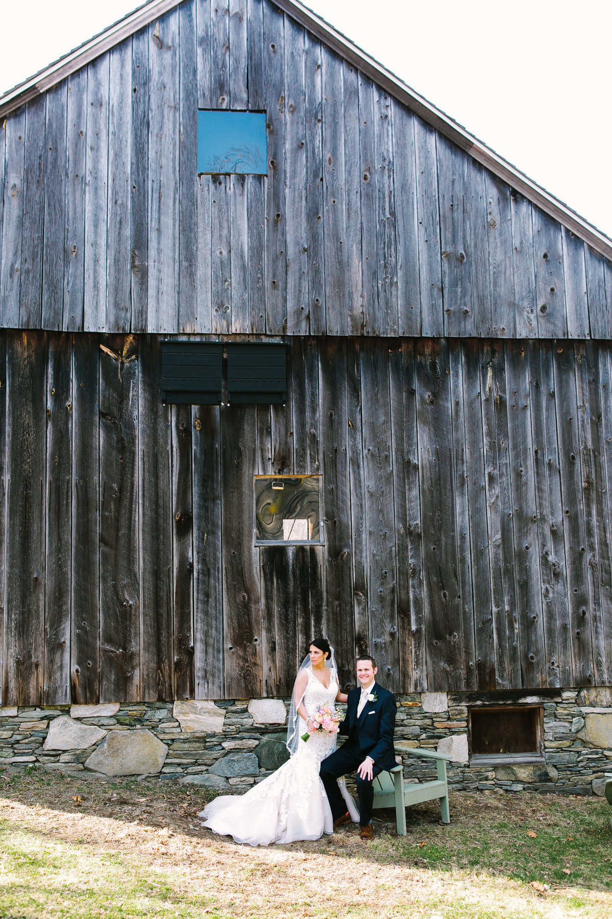bride and groom by the barn