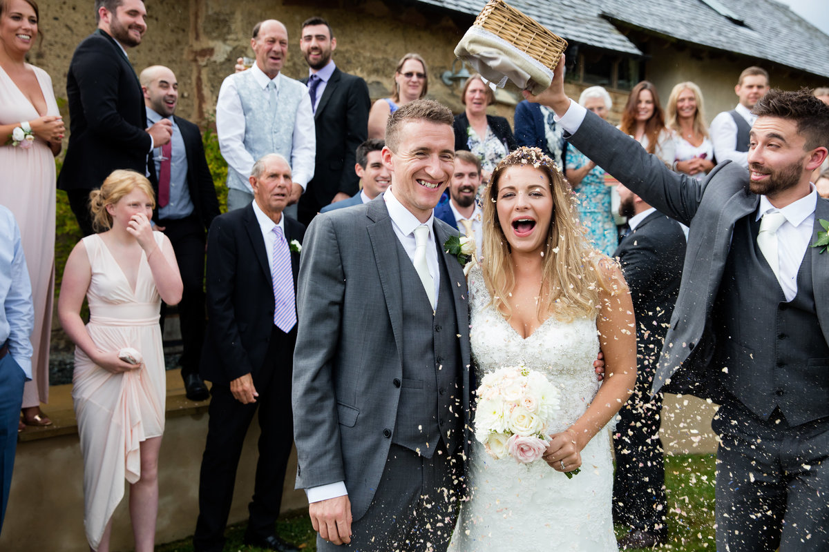 confetti at the oak barn august wedding in exeter