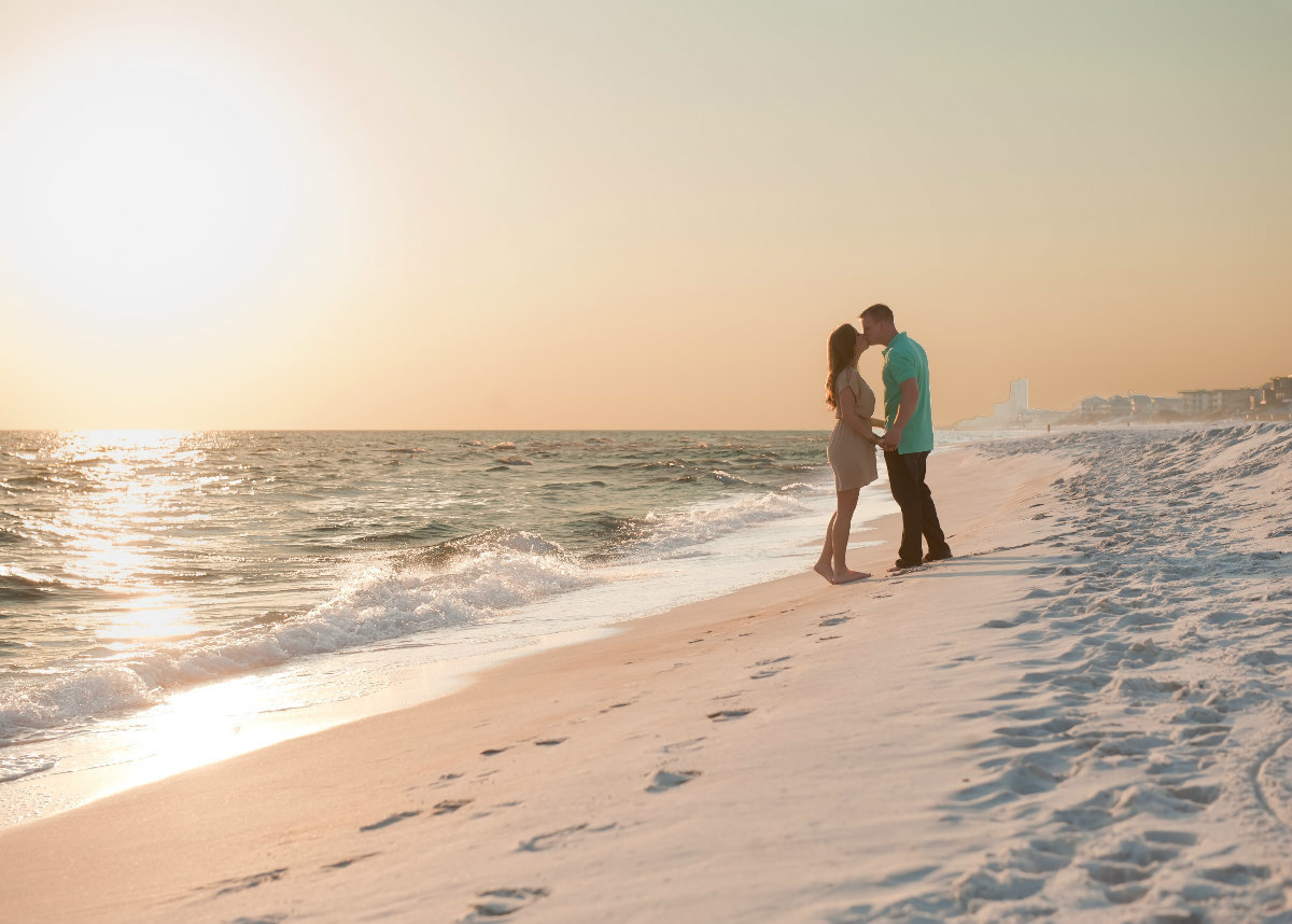 Couple kissing in the sunset on seacrest beach florida 30a