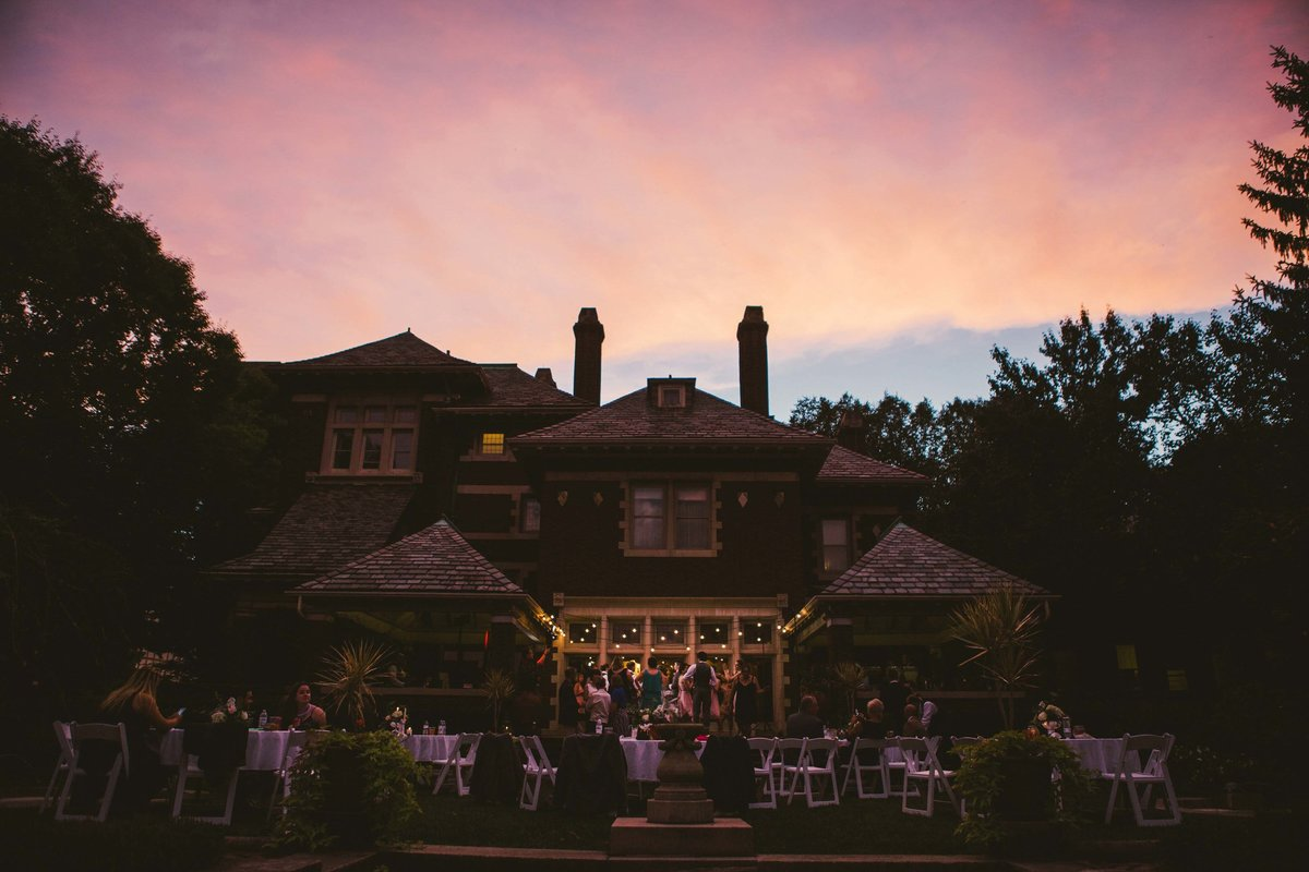 Irwin Gardens property lit up by lights and the sunset at outdoor wedding in Columbus Indiana