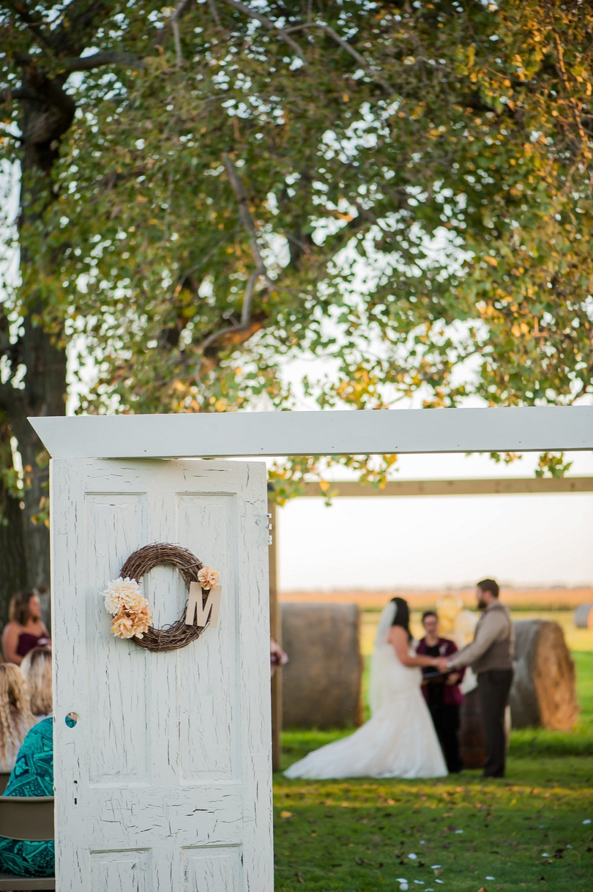 Sunset outdoor wedding ceremony in North Dakota prairies, photos by Fargo Photographer Kris Kandel