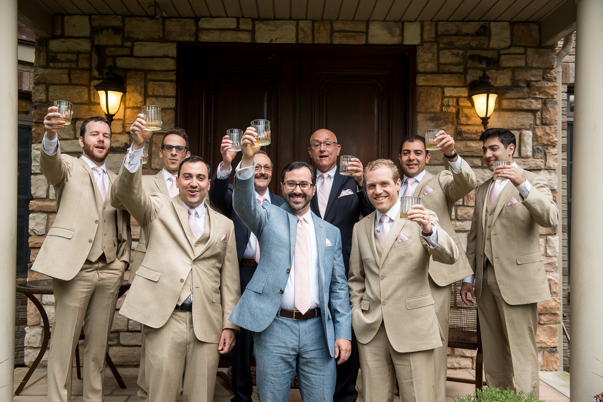 Brooklyn Wedding Photographer | Rob Allen Photography | Destination Wedding Photographer at Mt. Sinai New York  groom and groomsmen toasting