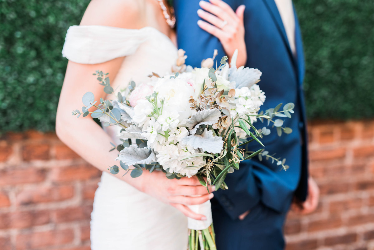 The best blue suit in the business paired with the best bouquet
