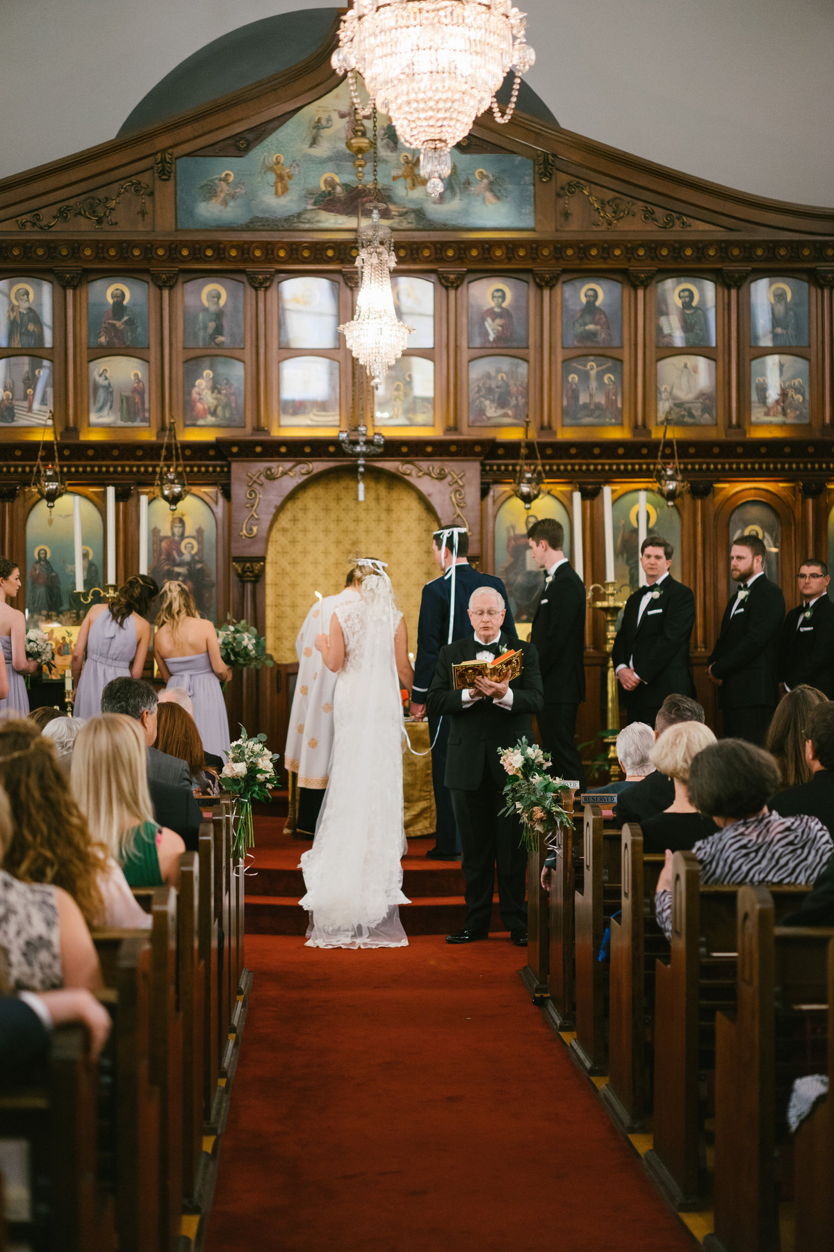 bride and groom standing at altar in greek orthodox wedding at St. Sophia Greek Orthodox Church in San Antonio