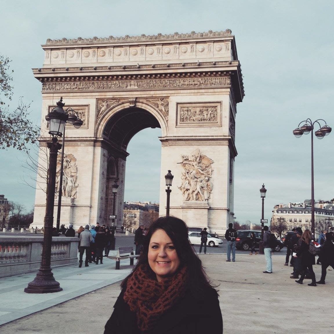 Jill Blue Photography stands near the arc de triumph in paris, france
