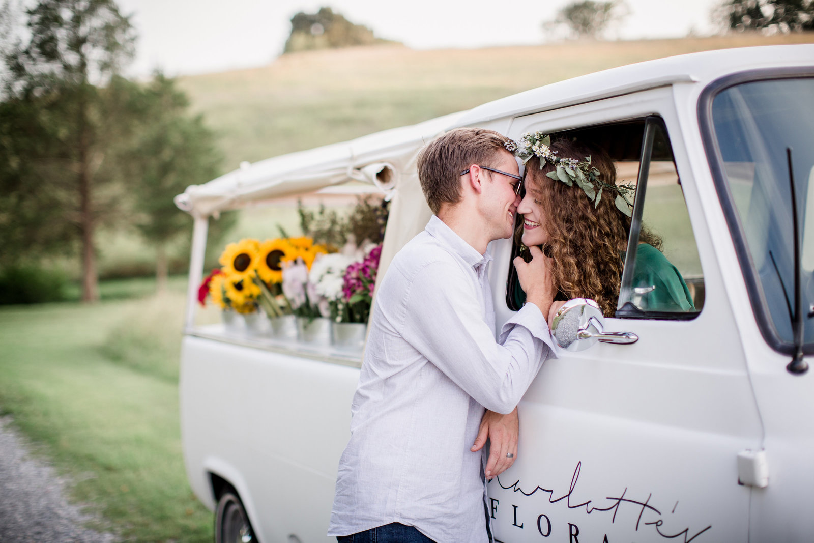 Kissing out the window of a vintage flower truck for their engagement session by Knoxville Wedding Photographer, Amanda May Photos.