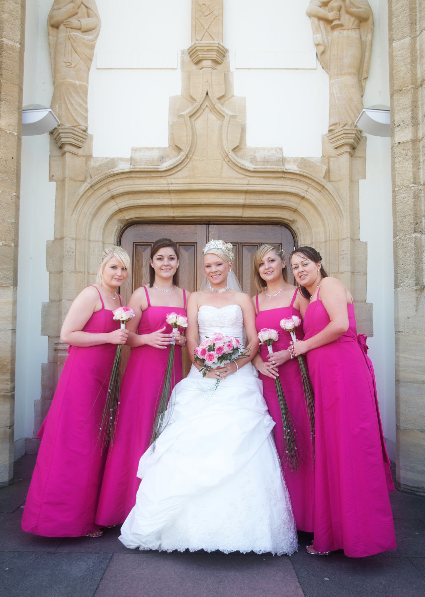 Brides mades in pink dresses Hertfordshire