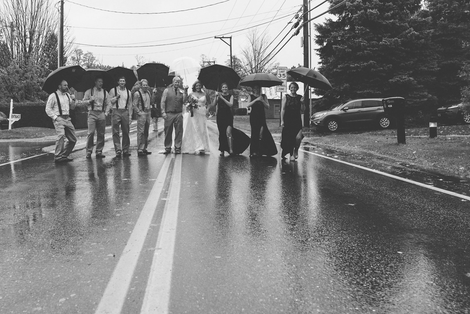 bridal party in the rain, bridal party with umbrellas, black and white wedding photos, Vermont wedding photographer, fall wedding in Vermont