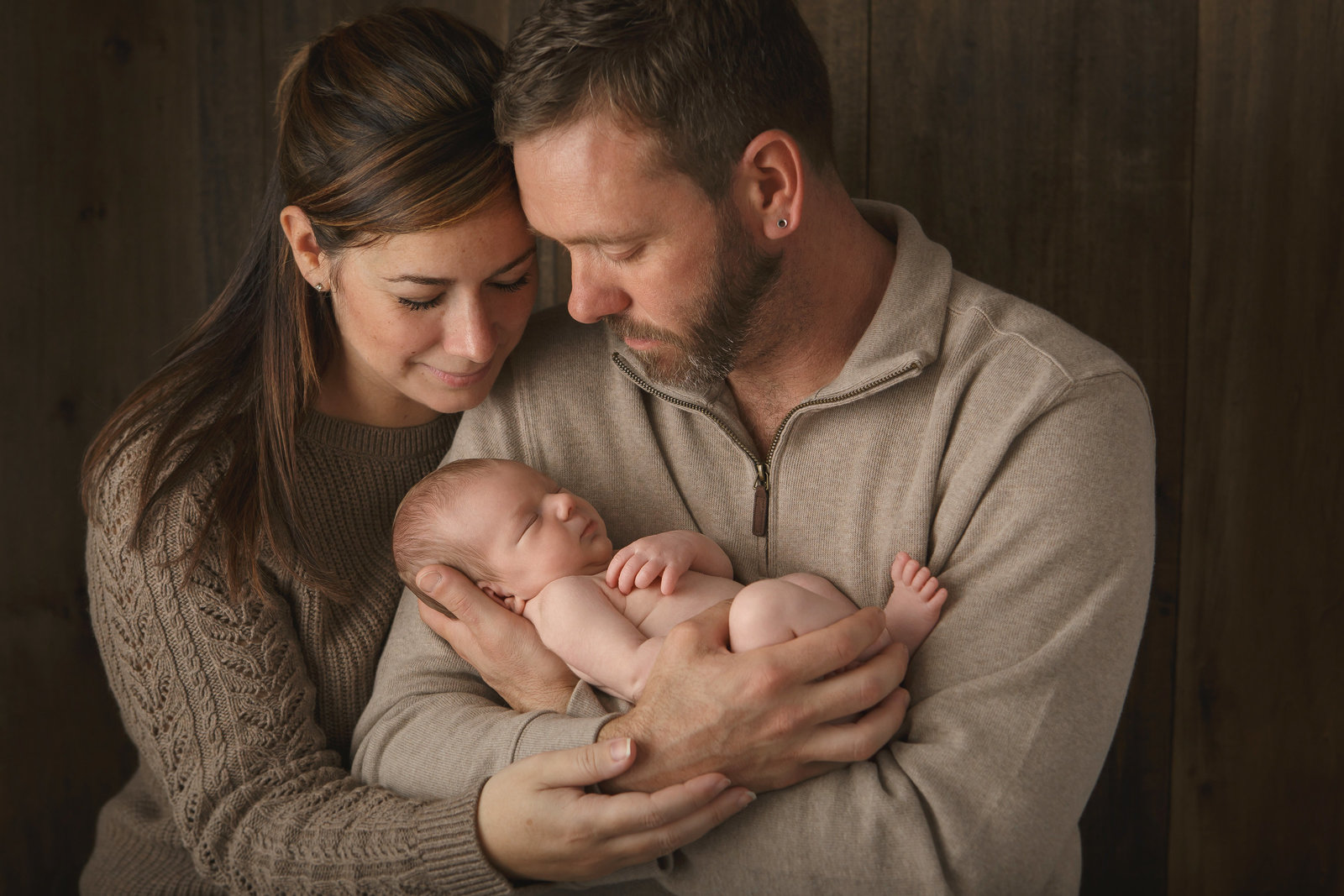 Poughkeepsie family with newborn baby in Cornwall NY studio by professional photographer in Hudson Valley