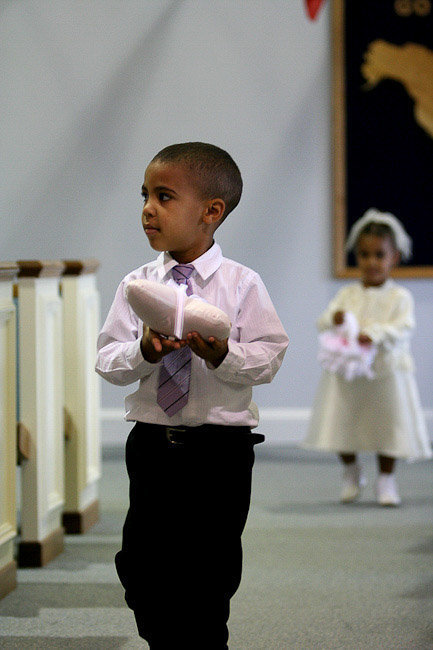wedding photography ring bearer and flower girl in aisle