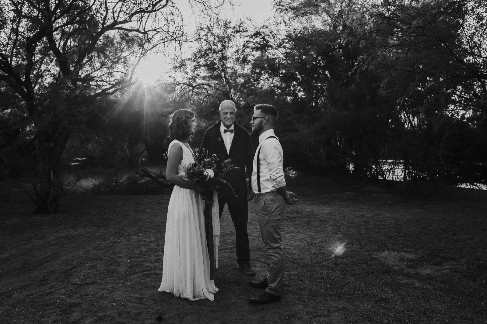 Elopement couple holding hands along the Salt River in Mesa, Arizona