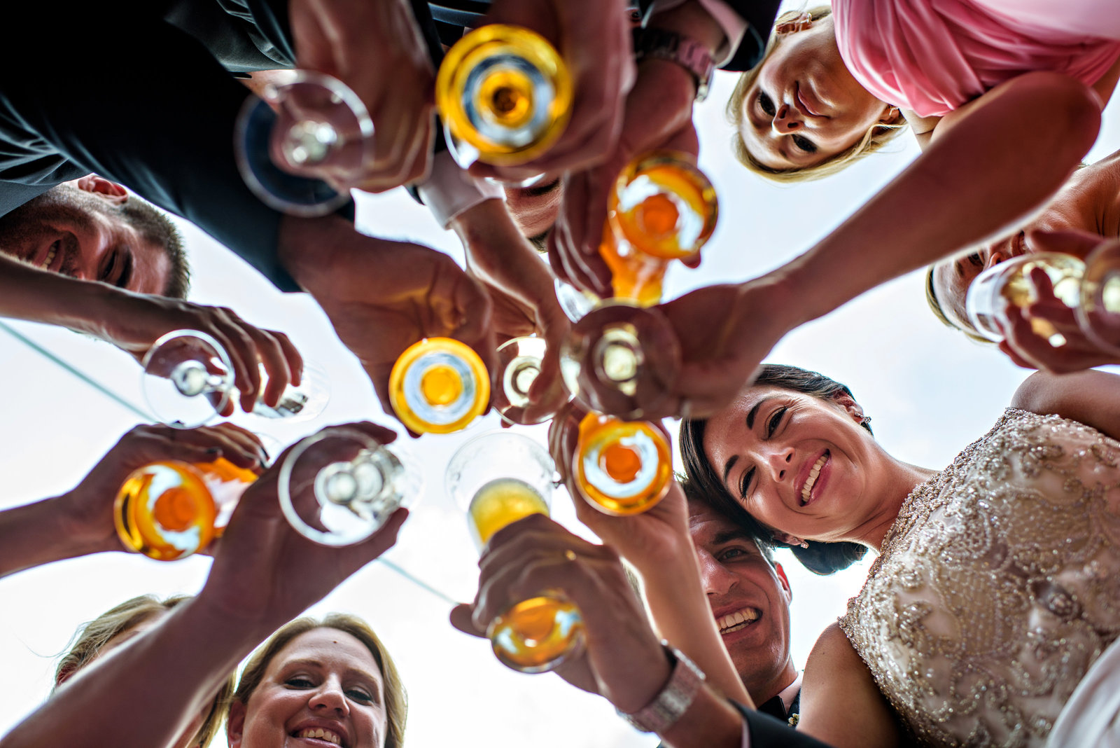 A bridal party cheers to the new couple.