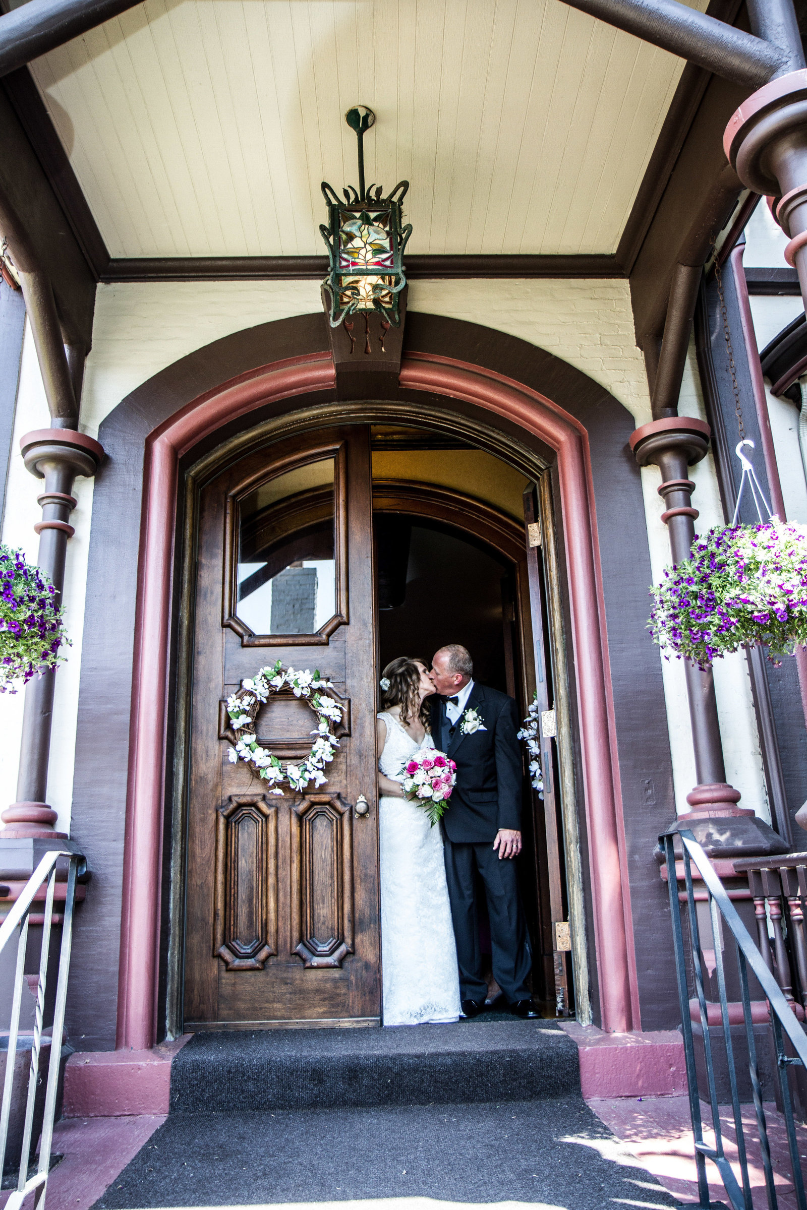 wedding photography bride and groom doorway