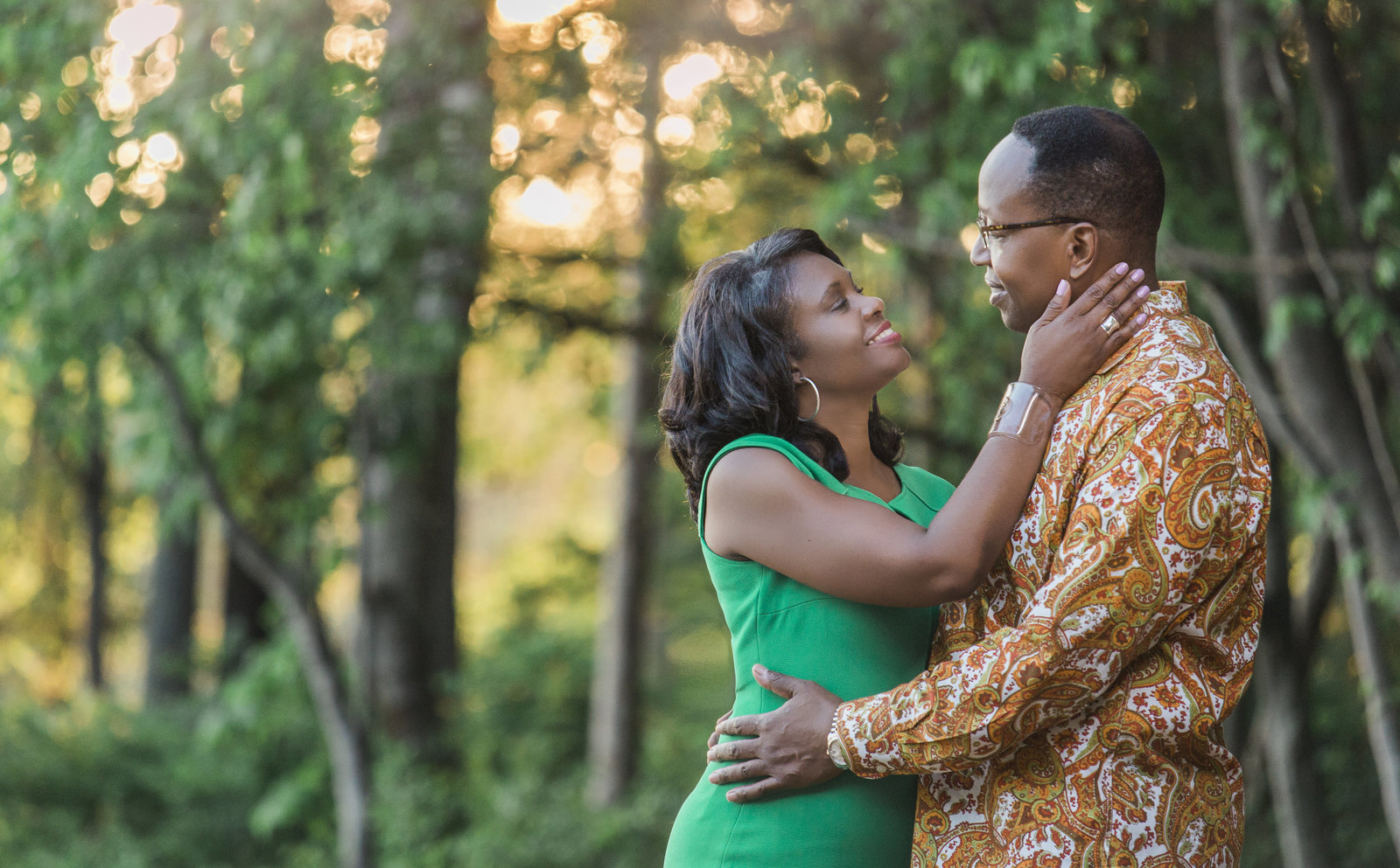 charlotte engagement photographer jamie lucido creates a beautiful engagement portrait in the woods at sunset