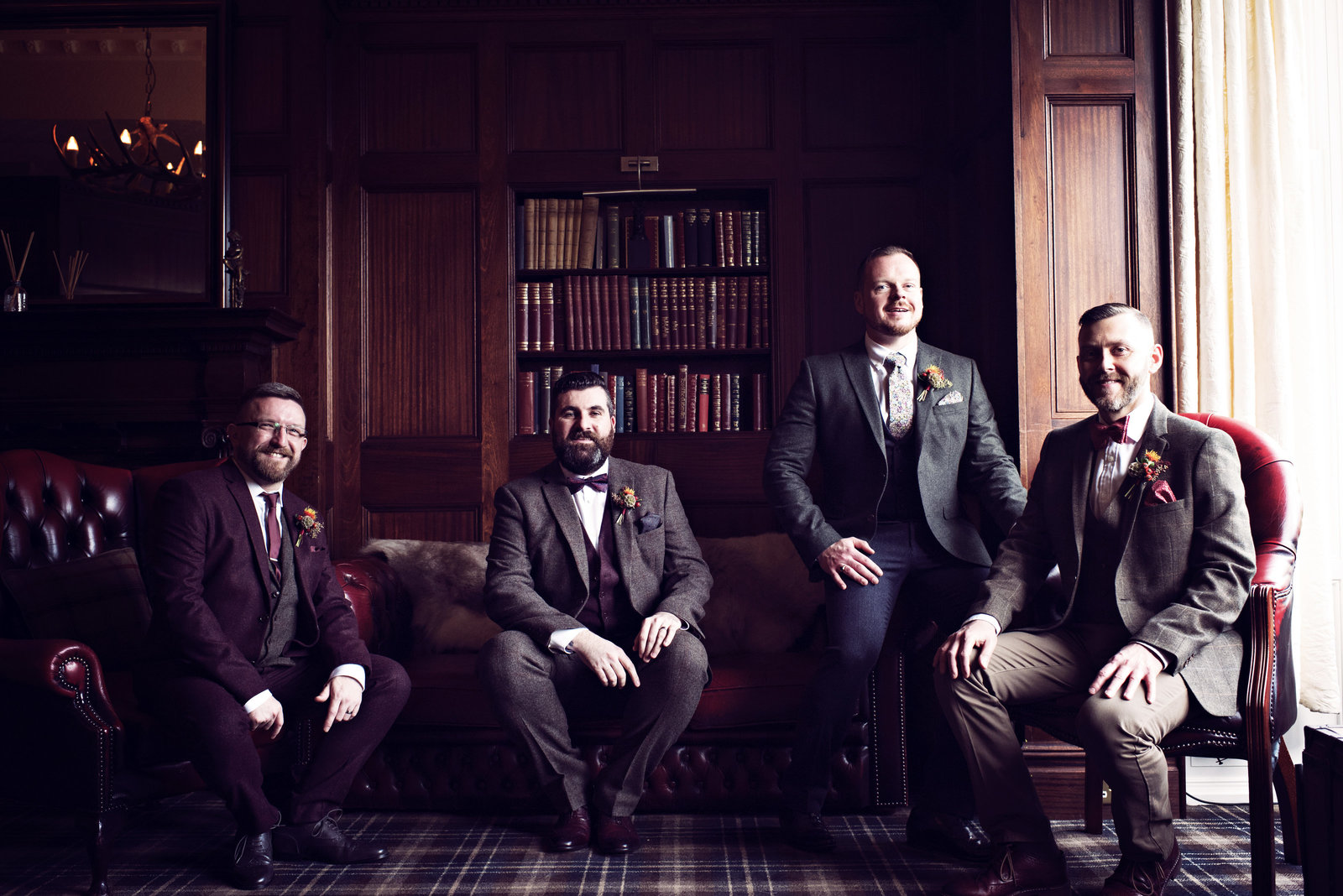 Groomsmen relax in the lounge before the ceremony at Ashfield House Hotel in Standish Lancashire