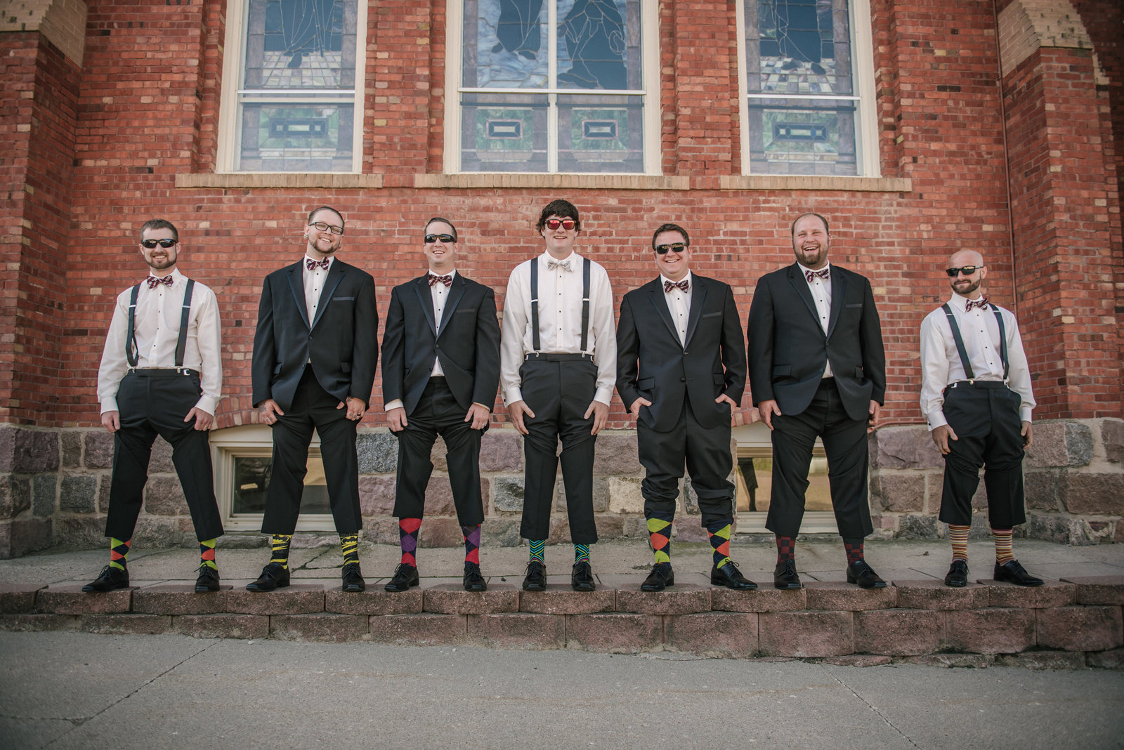 groomsmen showing off their fun socks