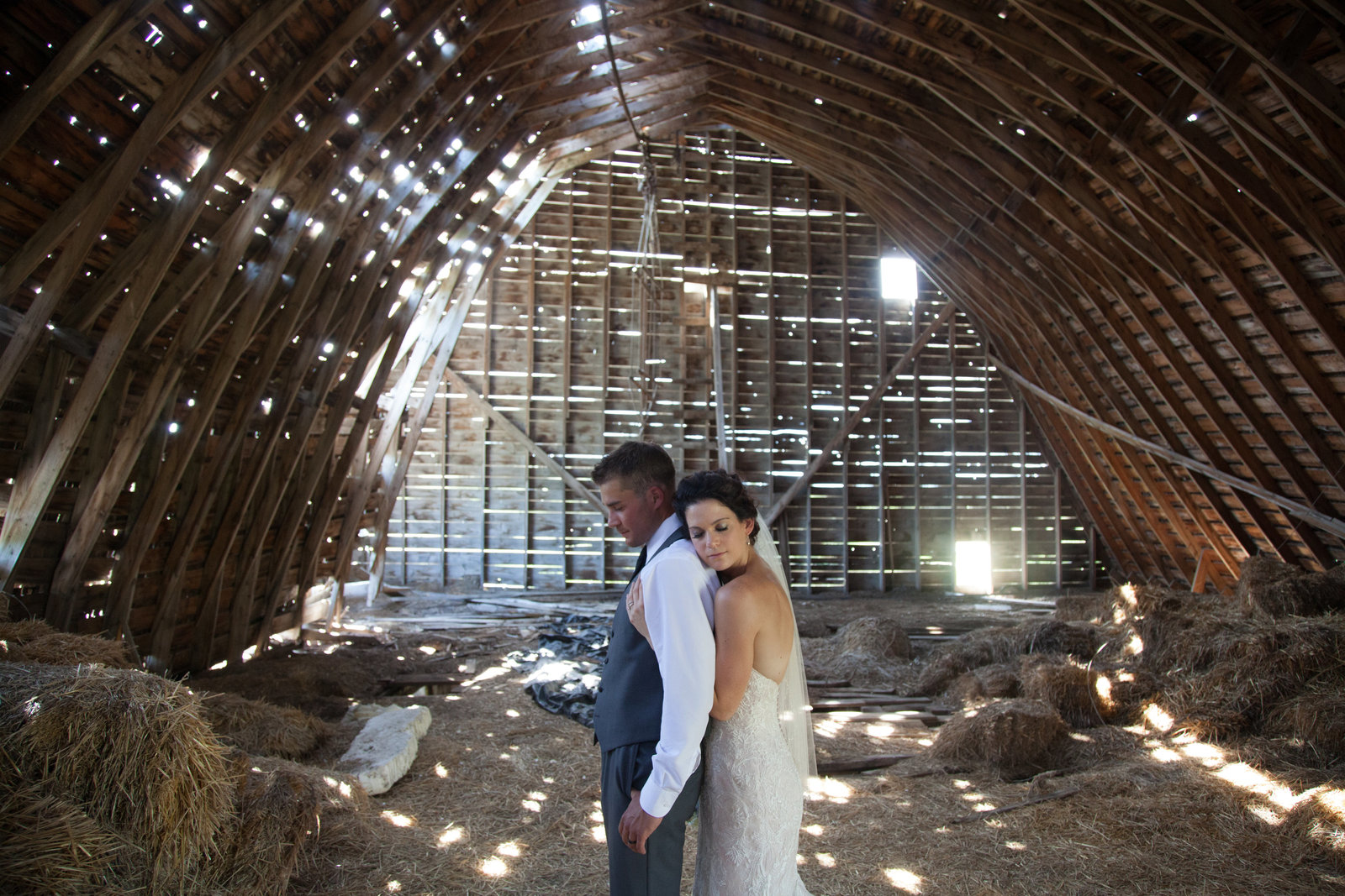 Bride and groom in barn, Saskatchewan Wedding Photogrpaher