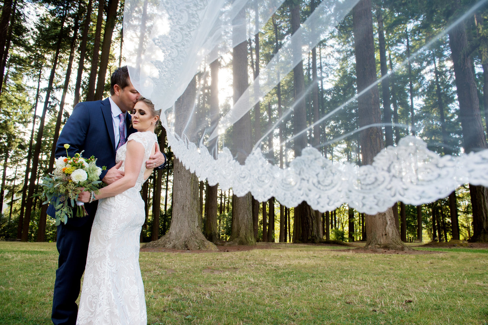 bride's veil flies in wind