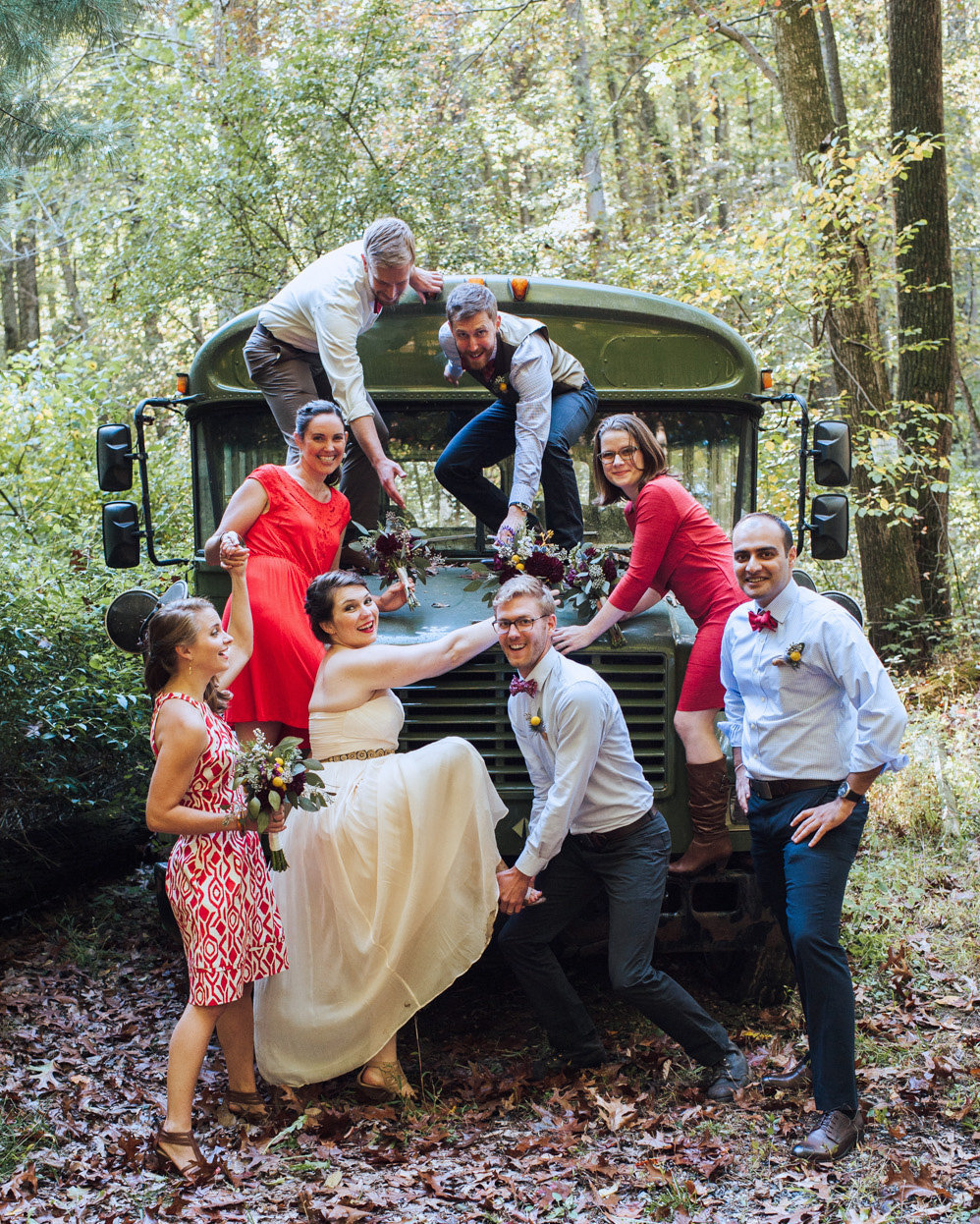 wedding party poses for portrait at rustic camp wedding
