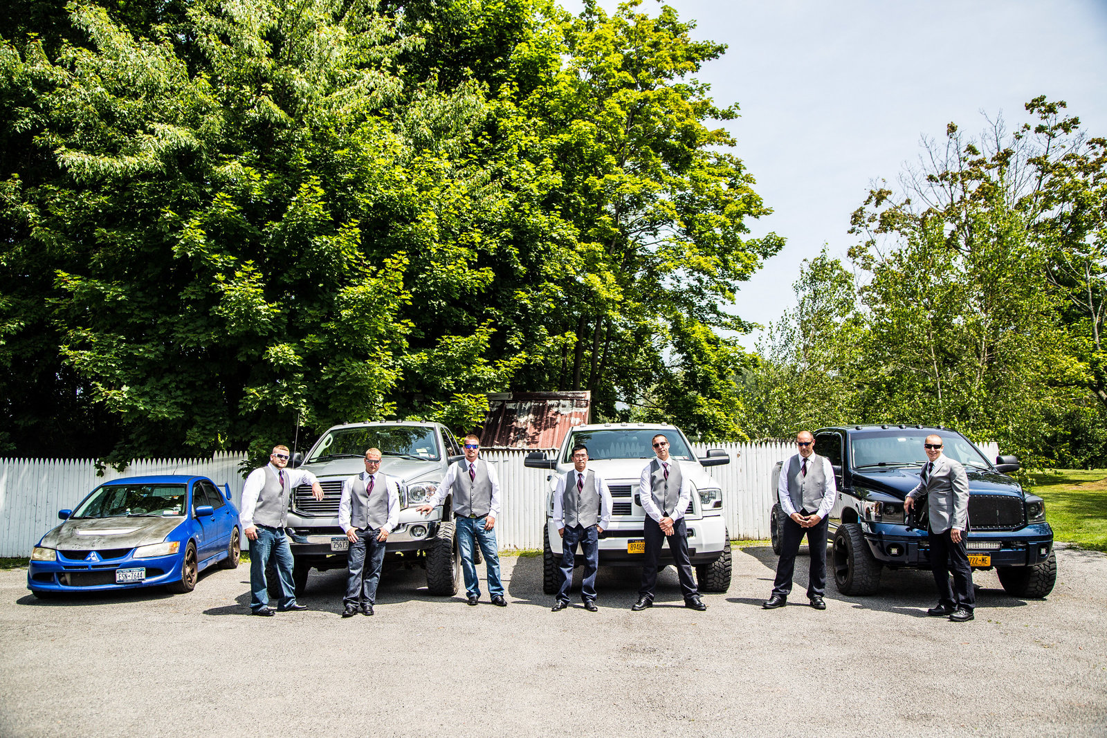 wedding photography groom and groomsmen with trucks