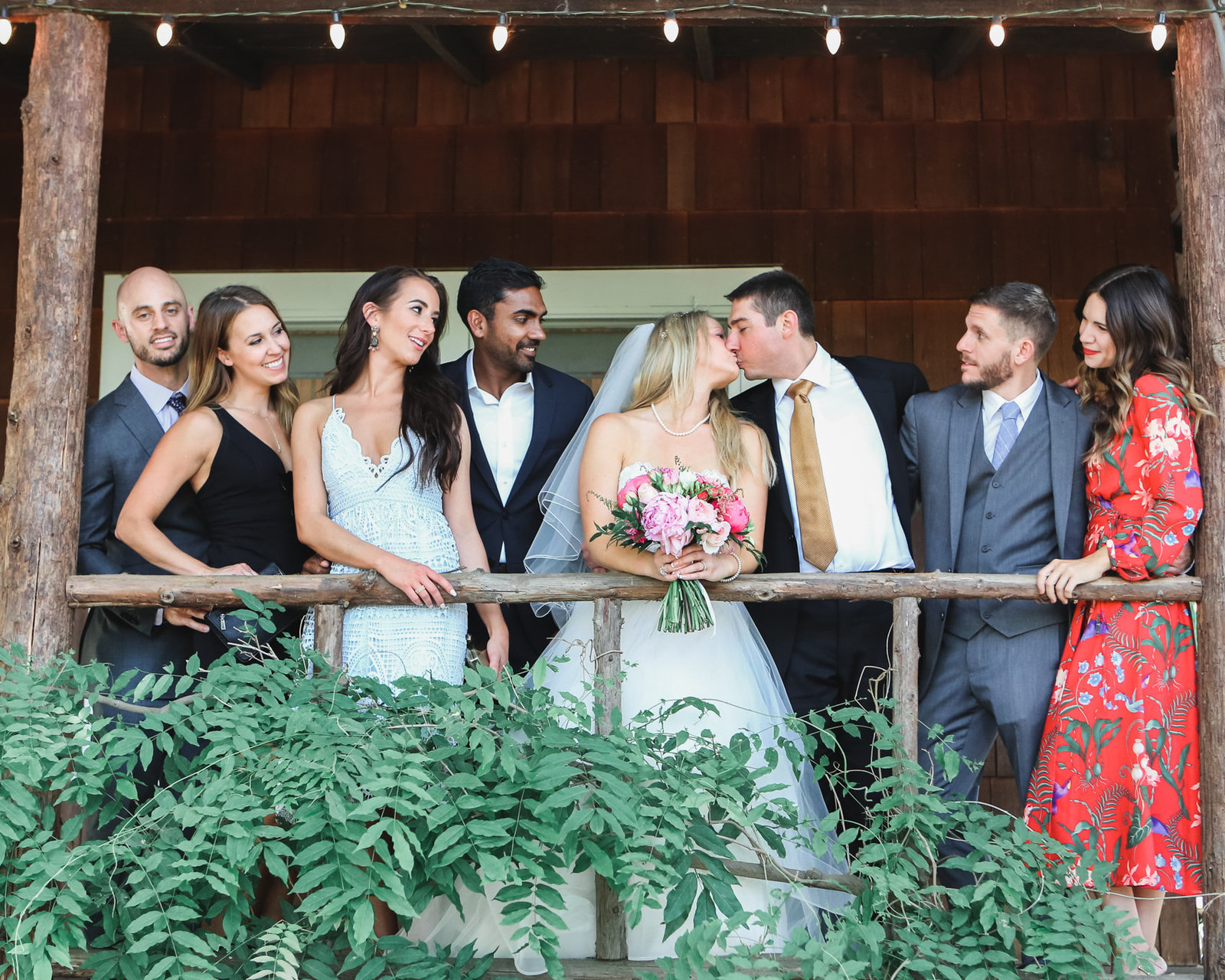 In beautiful rustic los altos wedding, the bride and groom pose with their familt